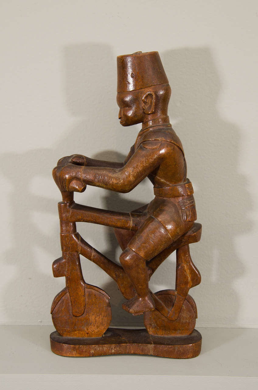 An early colonial carving from Kenya.  There is a rich tradition of carving colonial figures for sale to European colonists throughout Africa. Many of these master carvers carved figures for both local and foreign patrons.  This rare and