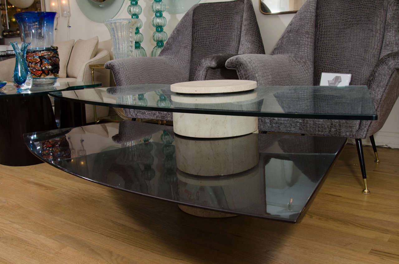 Adjustable, bi-level modern coffee table composed of travertine, wood and glass.