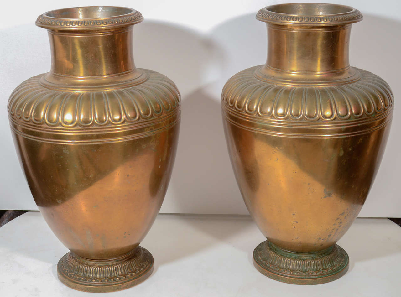 Tiffany bronze urns with simple egg and dart detailing from the 20th century. This can be seen at our 2420 Broadway location on the upper west side in Manhattan.