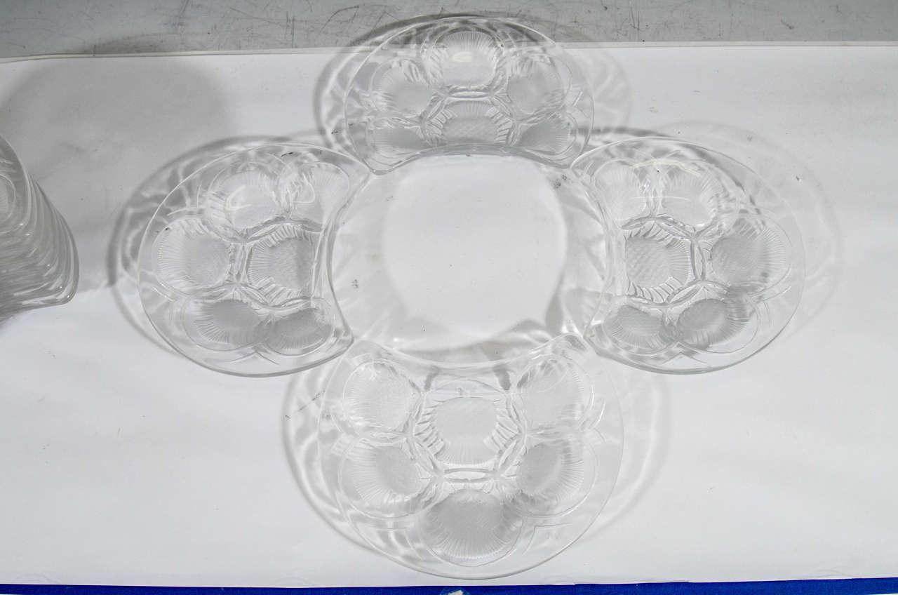 A vintage set of 12 crescent shaped crystal Chardon thistle dessert plates signed Lalique, France.