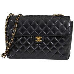 Authentic Chanel Black Classic Lambskin Maxi Handbag with Gold Tone Hardware