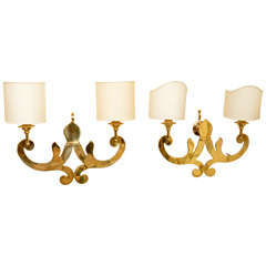 Pair of stylized brass scrolling arm sconces