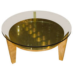 Brass and glass side table featuring three angular leg design