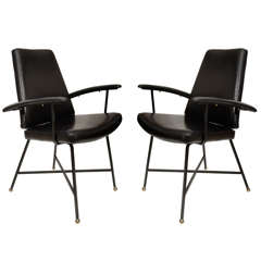 Pair of lacquered metal and leather armchairs by Jacques Quinet.