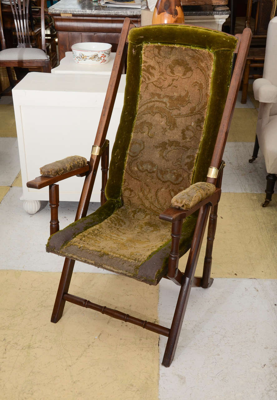 English FINE QUALITY WALNUT UPHOLSTERED FOLDING CAMPAIGN CHAIR. BACK FRAME  CONTOURED TO THE SHAPE OF