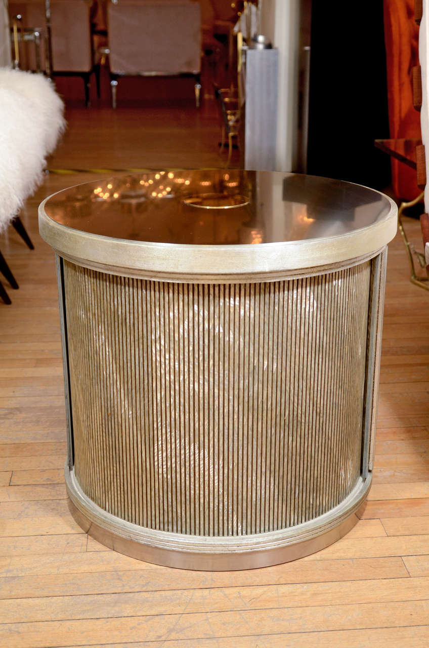 Pair of drum form side tables with sliding door compartment and faux finishing details.