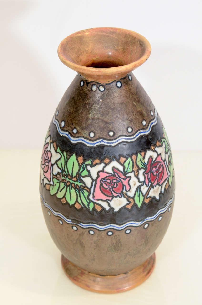 Brown stoneware ceramic vase with pastel glazed center decoration.