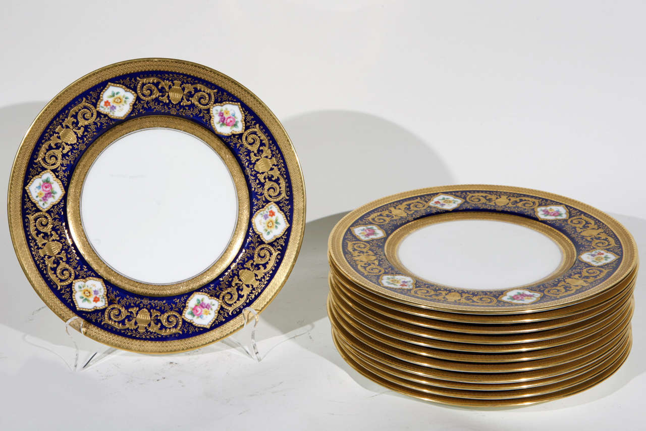 Set of 12 English Cowell and Hubbard Company Plates.  They are hand painted with raised gold decoration.