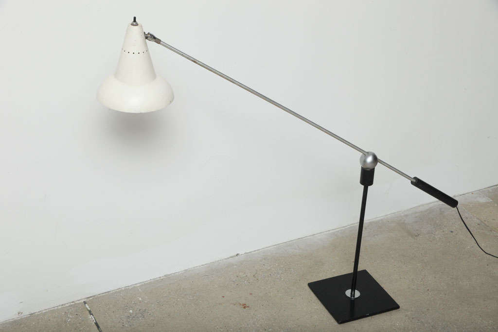 "Gilbert Waltrous for Heifetz Manufacturing Co. table lamp. The arm balances on a magnetic 3"" ball perched on a rod mounted on a black enameled square base and can rotate 360 degrees.