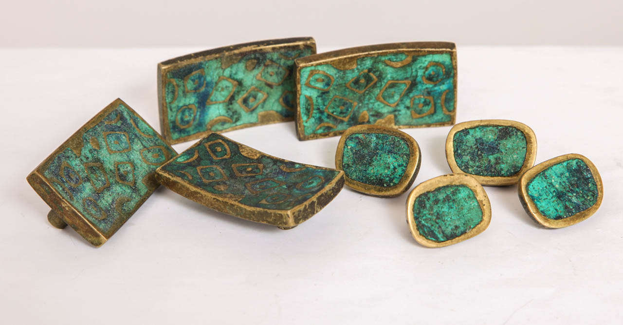 Mid-century Pepe Mendoza drawer pulls in brass with ceramic inlay. Of the larger, rectangular pieces, all four are signed with impressed manufacturer's mark [Mendoza Hecho en Mexico] and patent date [May 07- 58], and three have stickers; the