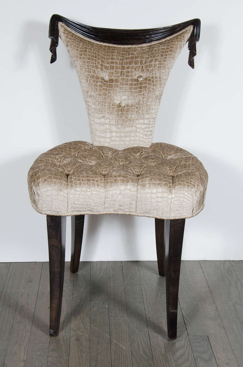 1940s Hollywood Regency draped design chair by Grosfeld House in ebonized walnut and smoked topaz gauffraged crocodile velvet upholstery. This elegant 1940s Hollywood Regency chair by Grosfeld House features a stunning hand carved draped design back