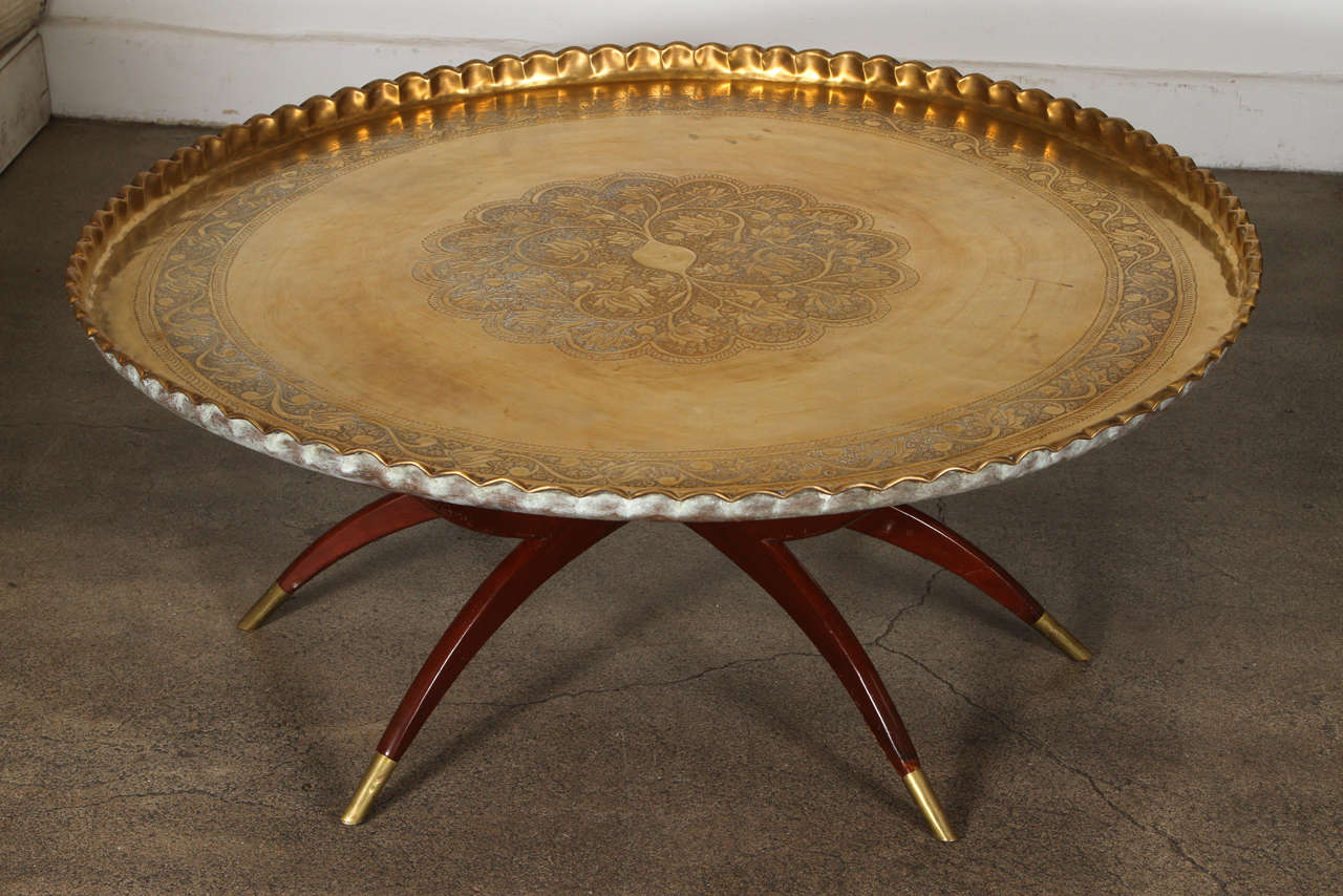 Engraved and embossed large 45 inches round Moroccan brass tray table. Polished brass tray, very good condition, standing on folding mahogany base with six legs. Very hard to find 45 inches diameter large Moroccan hand-hammered brass tray coffee