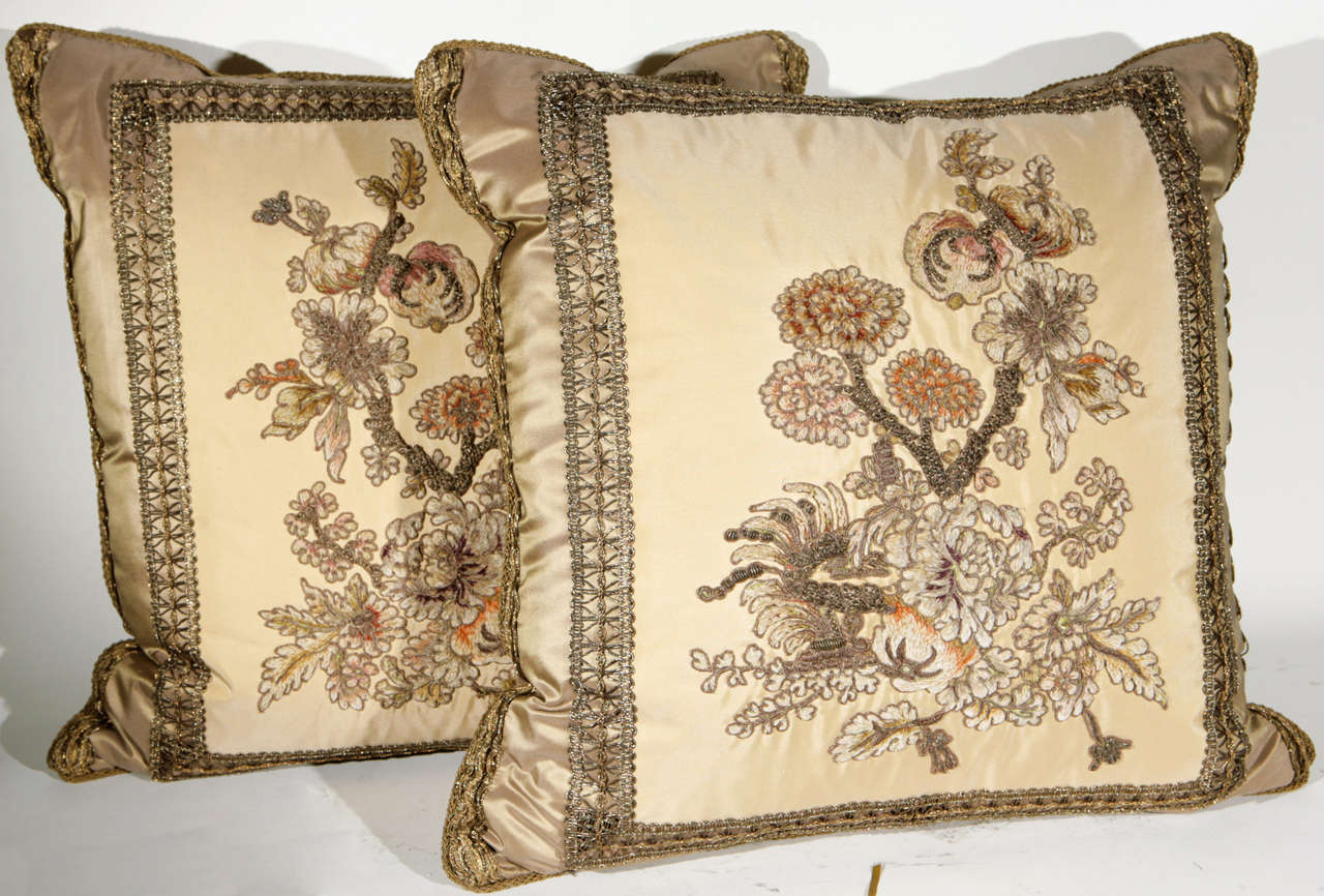 A very fine pair of early 19th c. French Fragment Pillows. The  metal thread tapestry fragments have been meticulously restored and masterfully sewn onto silk fabric to create these beautiful pillows. Decorative silk trim has been applied to finish