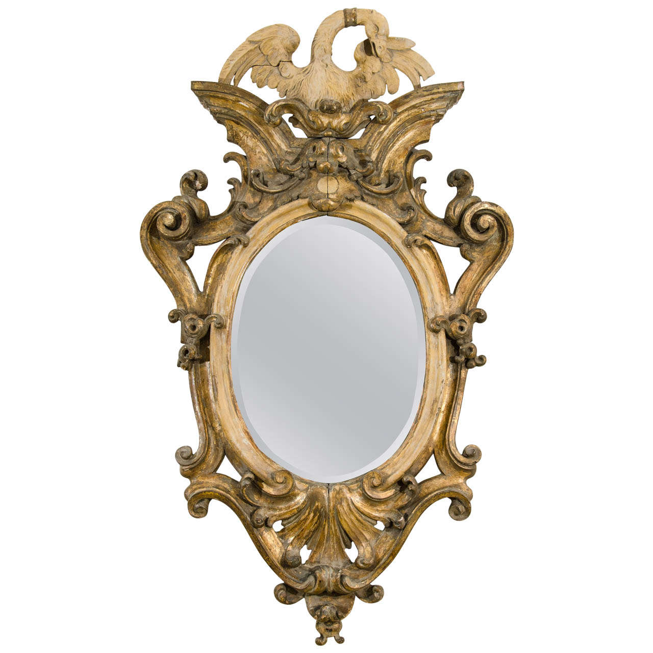 A 19th century italian baroque style giltwood mirror at for Baroque oval mirror