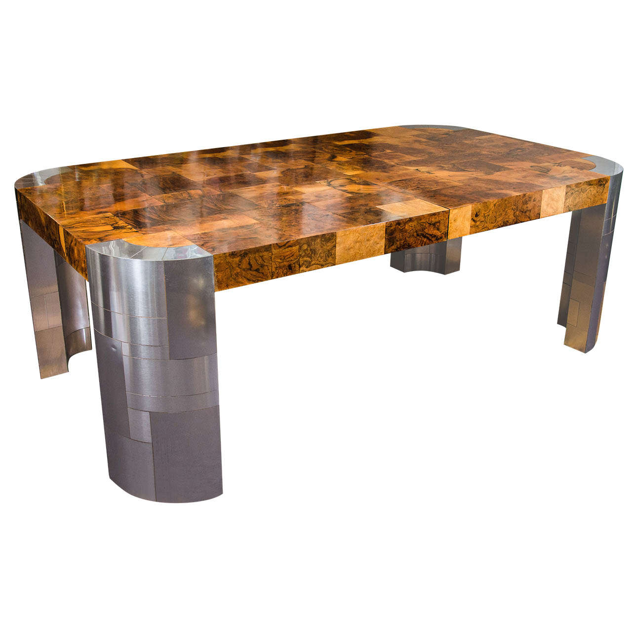 a mid century paul evans burled patchwork dining table at
