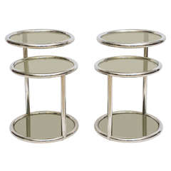 A Pair of Late Art Deco Chrome & Smoked Glass Swivel Tables by Glibert Rohde