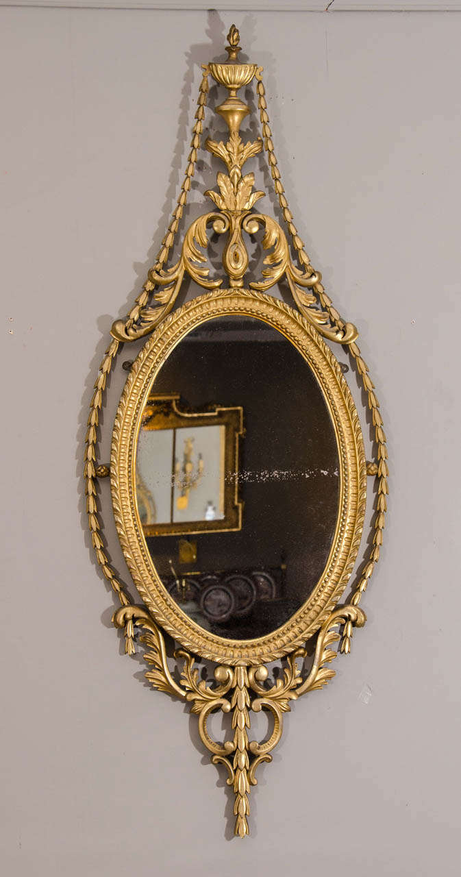 Pair of Late 19th Century English Adam Style Gilt Oval Mirrors In Excellent Condition For Sale In New York, NY