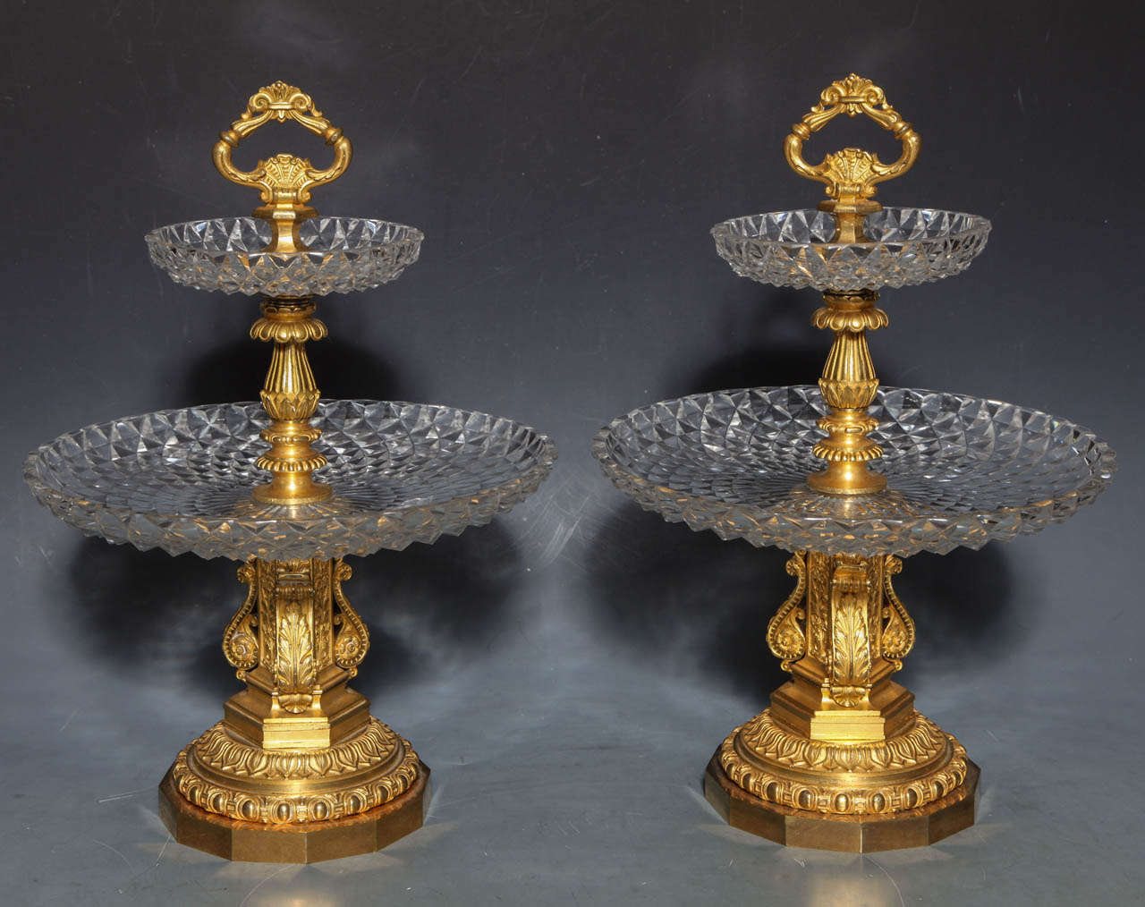 A fine pair of Antique French Neoclassical hand diamond cut Crystal and Dore Bronze Two Tiered Tazzas/Centerpieces, Signed by Pierre-Philippe Thomier (1751–1843). The diamond cut trays sparkle against Dore bronze mounts of the finest quality. The