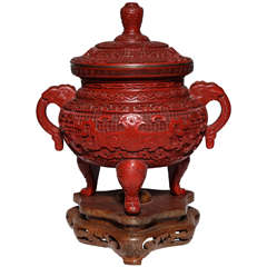 A Monumental Chinese Cinnabar Red Lacquer Incense Burner of Archaic Form and Decoration