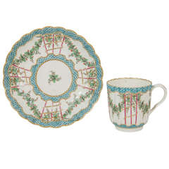 An 18th Century Soft Paste Worcester Hop Trellis Pattern Cup and Saucer