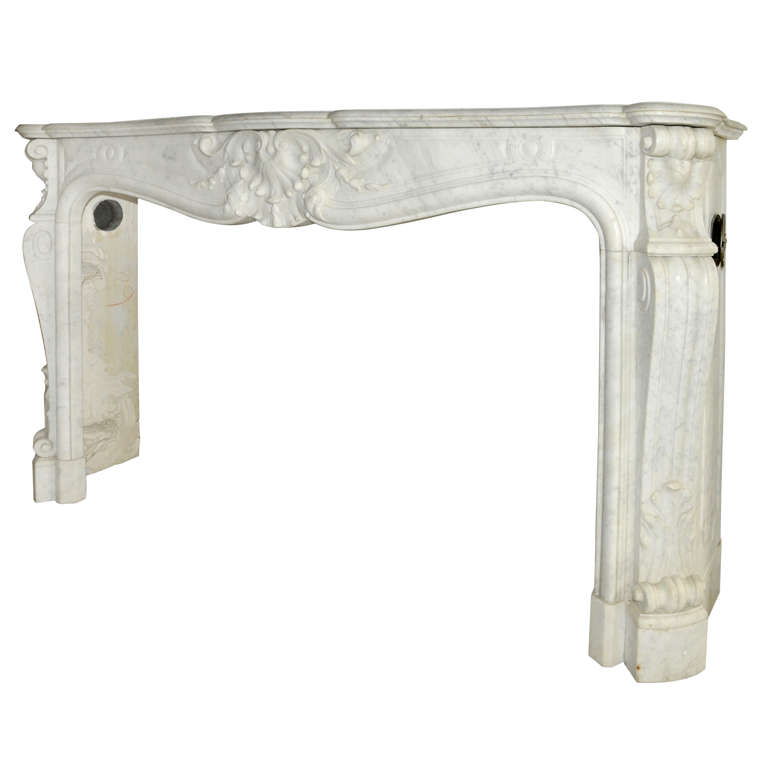 An early 19th century French Rococo Carrara marble fireplace / mantel piece