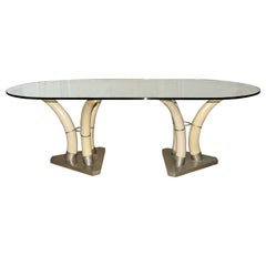 A 1960's French nickeled brass and resin elephant tusk dining room table