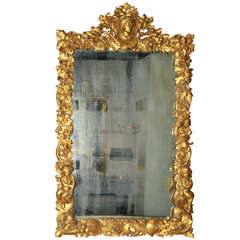 A carved oak 17th century frame with 19th century gold leaf