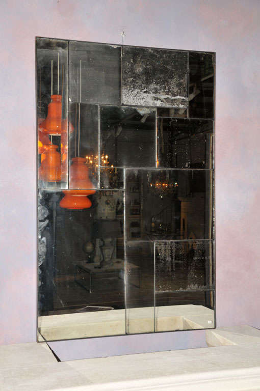 A Mirror Made Of 14 Pieces Of Antique Mirror Glass For