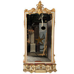A monumental sized 19th century French carved giltwood mirror with planter