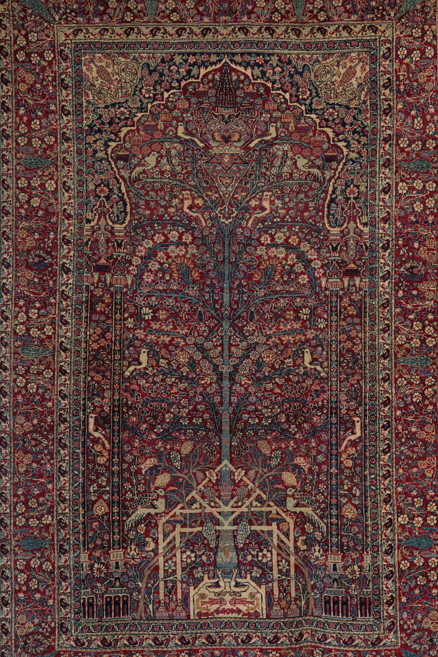 This Persian Tehran carpet circa 1900 features a Tree of Life design and consists of a cotton warp and thread, handspun hand-knotted wool pile and natural vegetable dyes. It is an exceptionally fine and detailed piece, in which the artist has