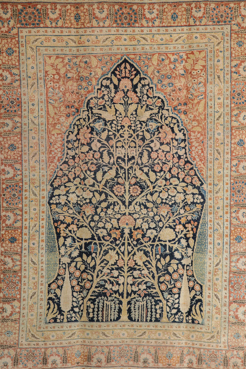 This Persian Haji Jalili Tabriz carpet circa 1880 features a tree of life design, hand-knotted handspun wool pile and natural vegetable dyes. Created in the workshop of master weaver Haji Jalili, one of the foremost artists of his time, this carpet