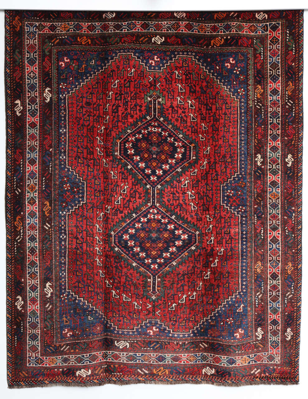 This Persian Qashqai carpet, circa 1920 consists of a pure handspun wool warp, weft and hand-knotted pile and organic vegetable dyes. Its geometric design is exceptionally detailed and balanced in both coloration and proportion. Exhibiting rich