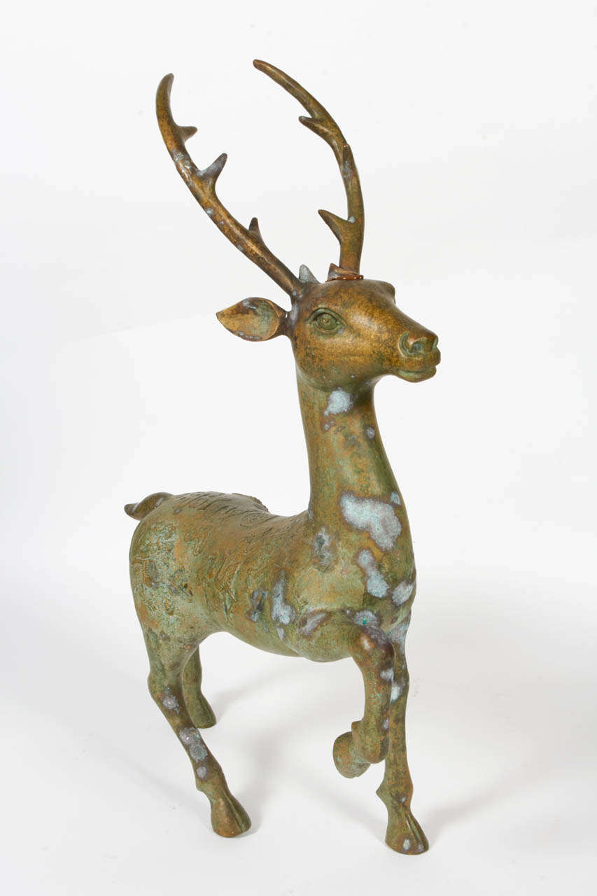 A bronze deer statue with Chinese characters of blessing and long life.  Early 20th century, cast bronze with embossing.  Wonderful patina, can be used inside or outside.