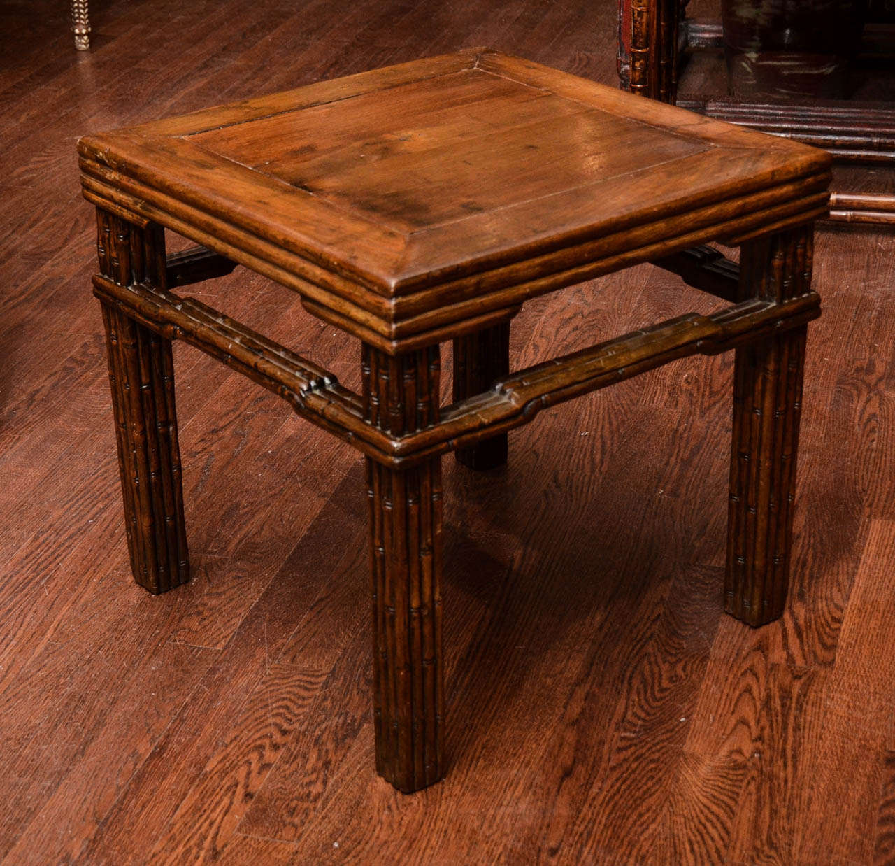Turn of the century Qing dynasty faux bamboo carved stool with reeded decoration.