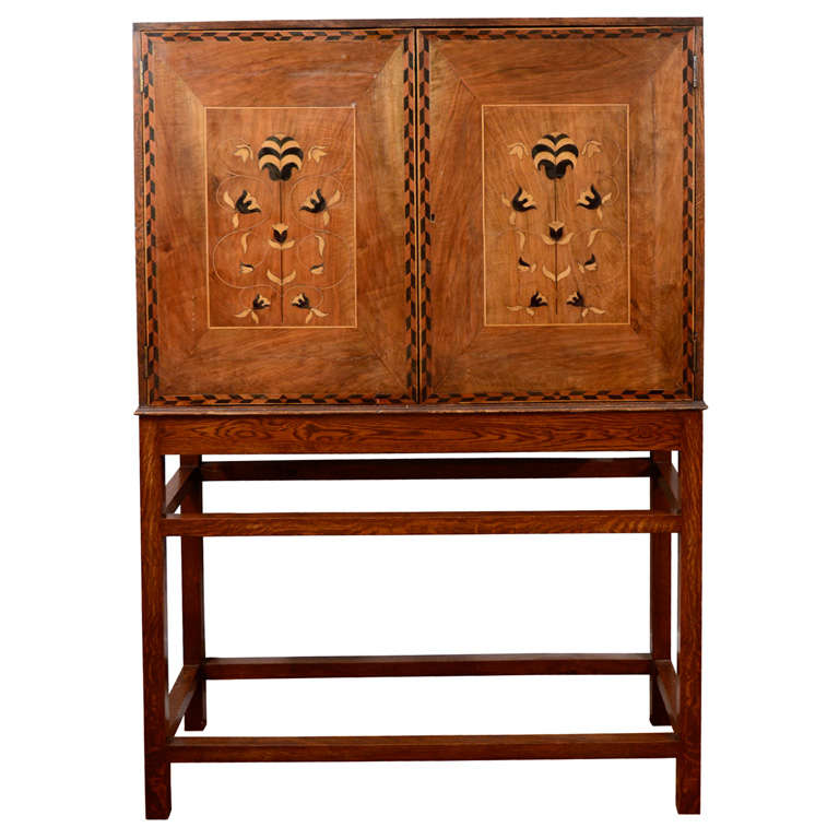 An english arts and crafts walnut and marquetry inlaid for Arts and crafts storage cabinet