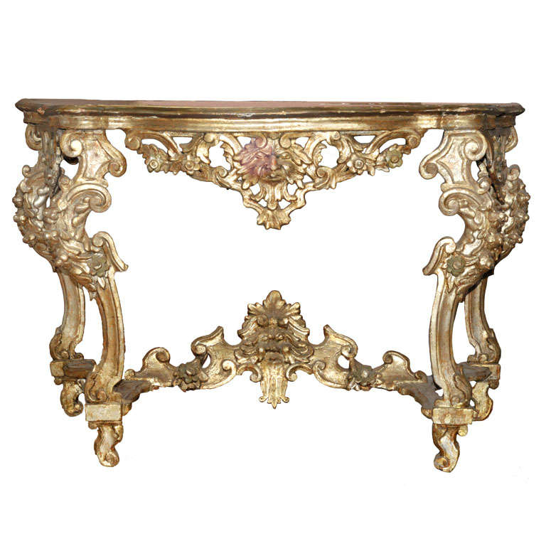 French Console Table an 18th century french regence carved silvered wood console table