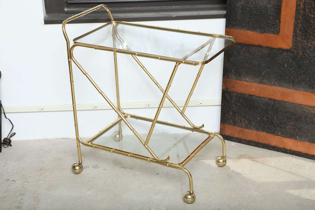 A bar cart of faux bamboo in brass.