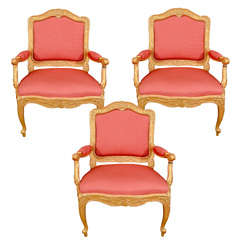 A Set Of Three Swedish Rococo Carved Giltwood Armchairs