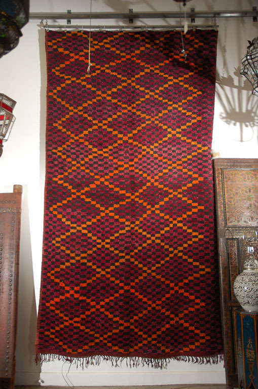 Handwoven vintage pile Moroccan tribal rug, purple, orange and black. Very lush and happy colors, Mid-Century Modern look, will add the tribal accent and life to any room. Bright lozenges in orange on a bed of purple. Circa 1960's. Happy, happy rug