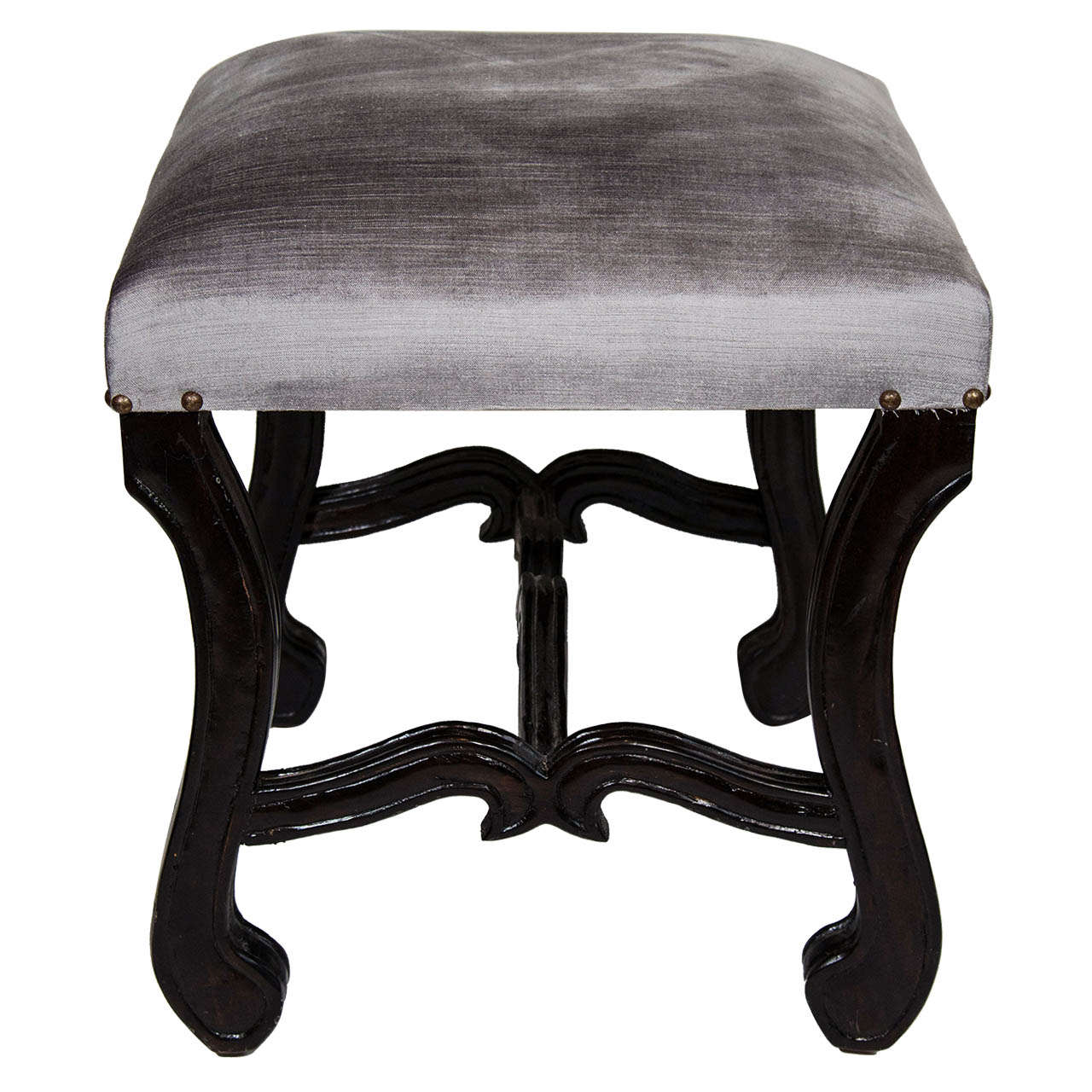 Elegant mid-century vanity stool with hand-carved walnut wood base in ebonized finish. Newly upholstered in luxe grey velvet with antique brass stud details. The bench features scrolled cabriole leg design and stylized cross stretcher with carved