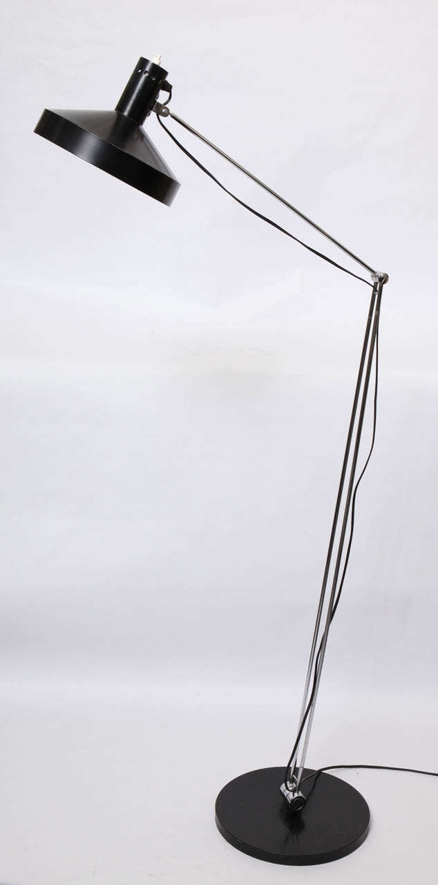 A 1950s articulated floor lamp by Rico & Rosemary Battensweller, Switzerland.