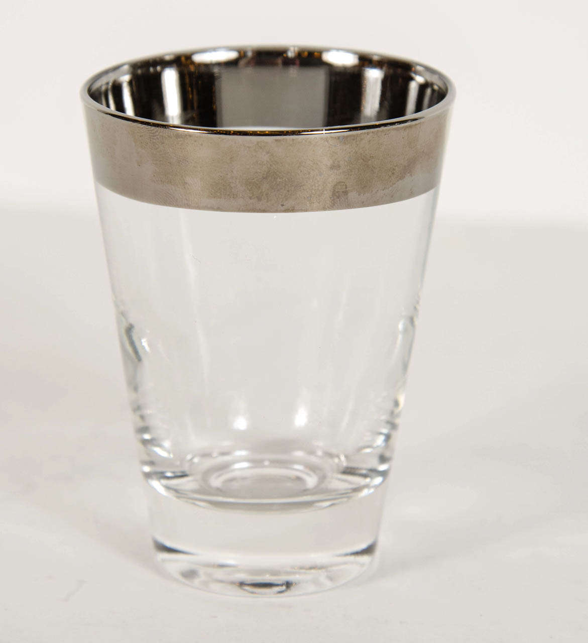 Set of 4 tumblers in hand blown glass with sterling bands on the top.