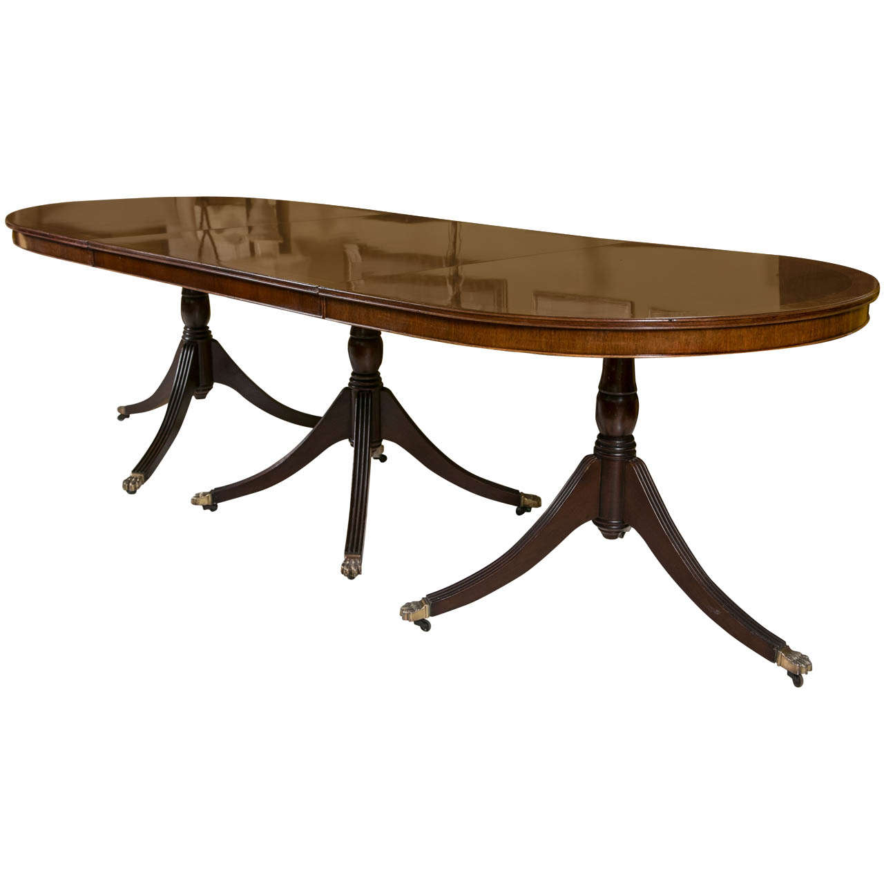 An English Georgian Style Triple Pedestal Banded Mahogany Dining