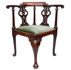 A good Geo II mahogany corner chair