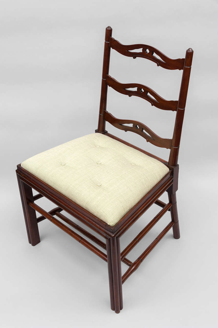 George III set of six mahogany Gillows dining chairs, of very unusual form. The backs with pierced splats and faux bamboo uprights, the cluster column legs and turned stretchers simulating bamboo.  Good color.  Fully illustrated and described in