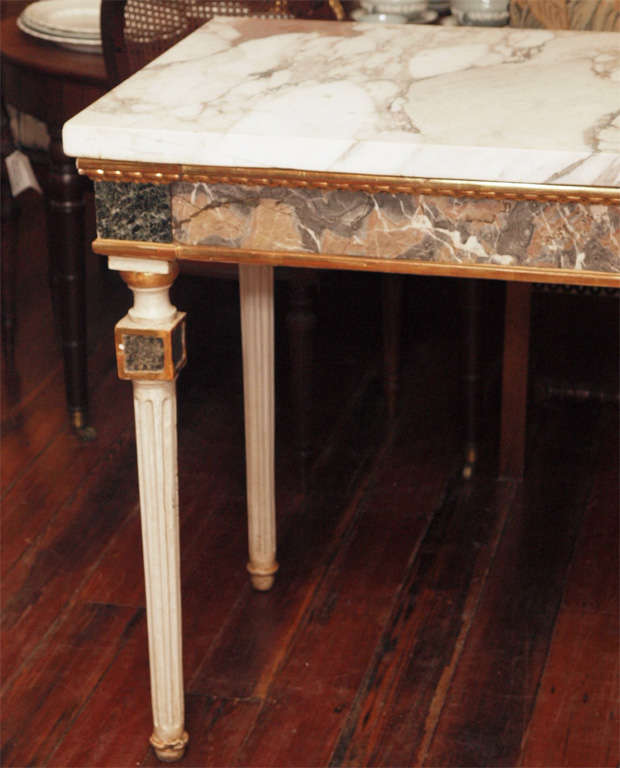 Pair of Marble inlaid, marble topped console tables. These are period Louis XV Italian.