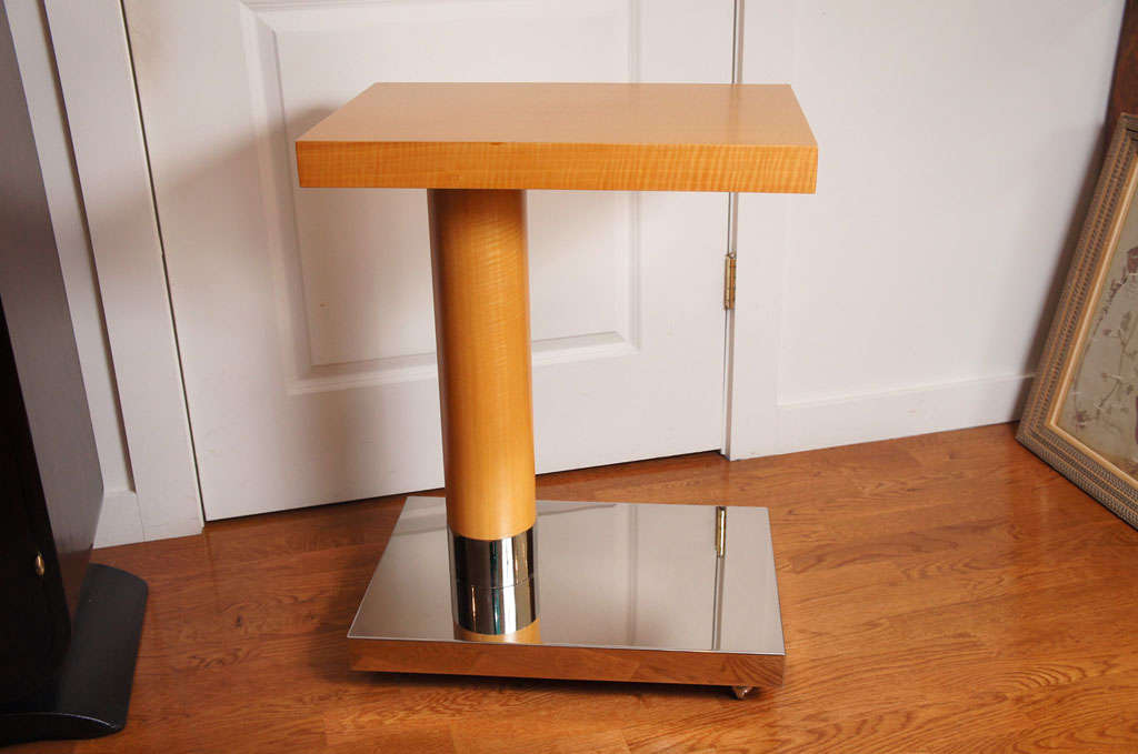 Sycamore veneer wood table top and pedestal, rests on a polished chrome rolling stand. A quantity of two are available.