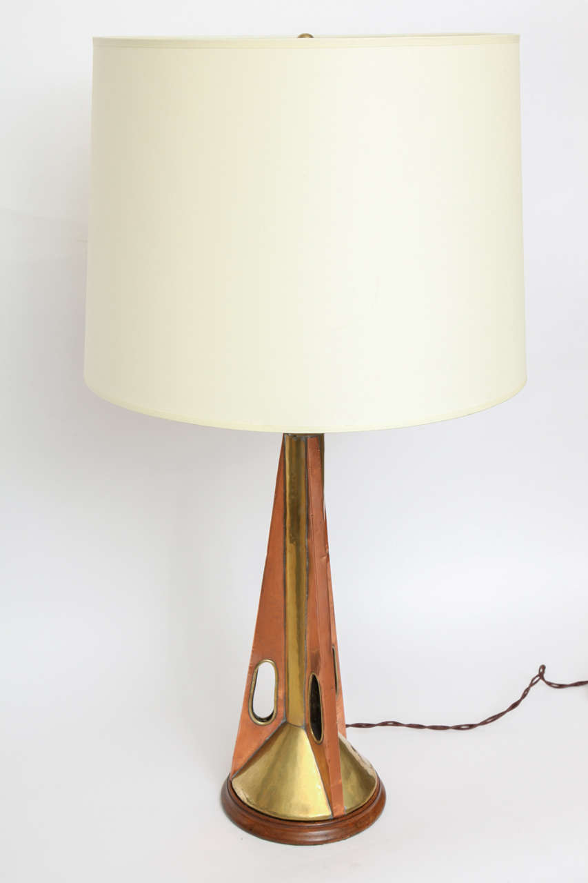 A 1960s brass and wood table lamp. Shade not included