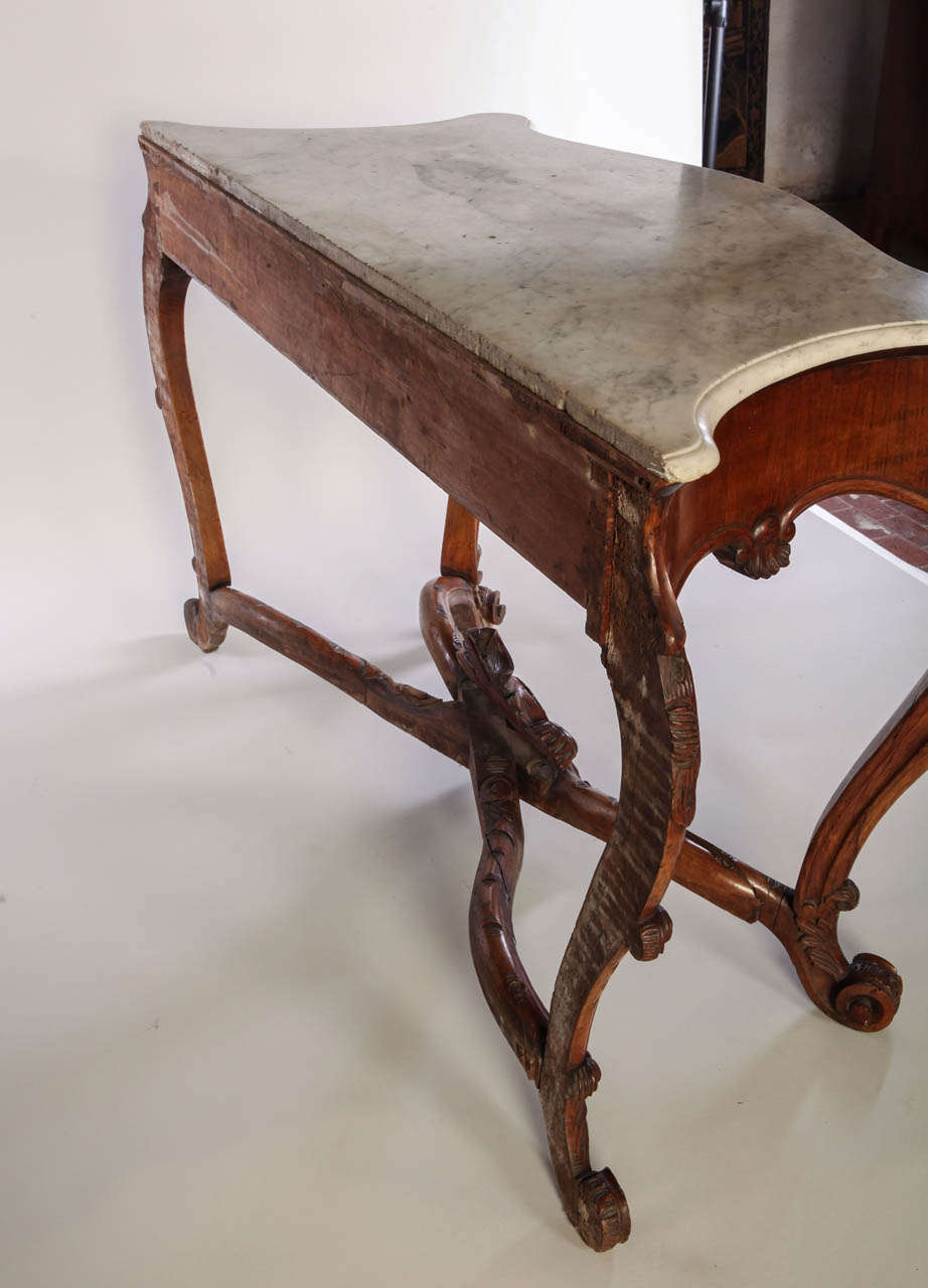 Italian th century carved walnut console table with