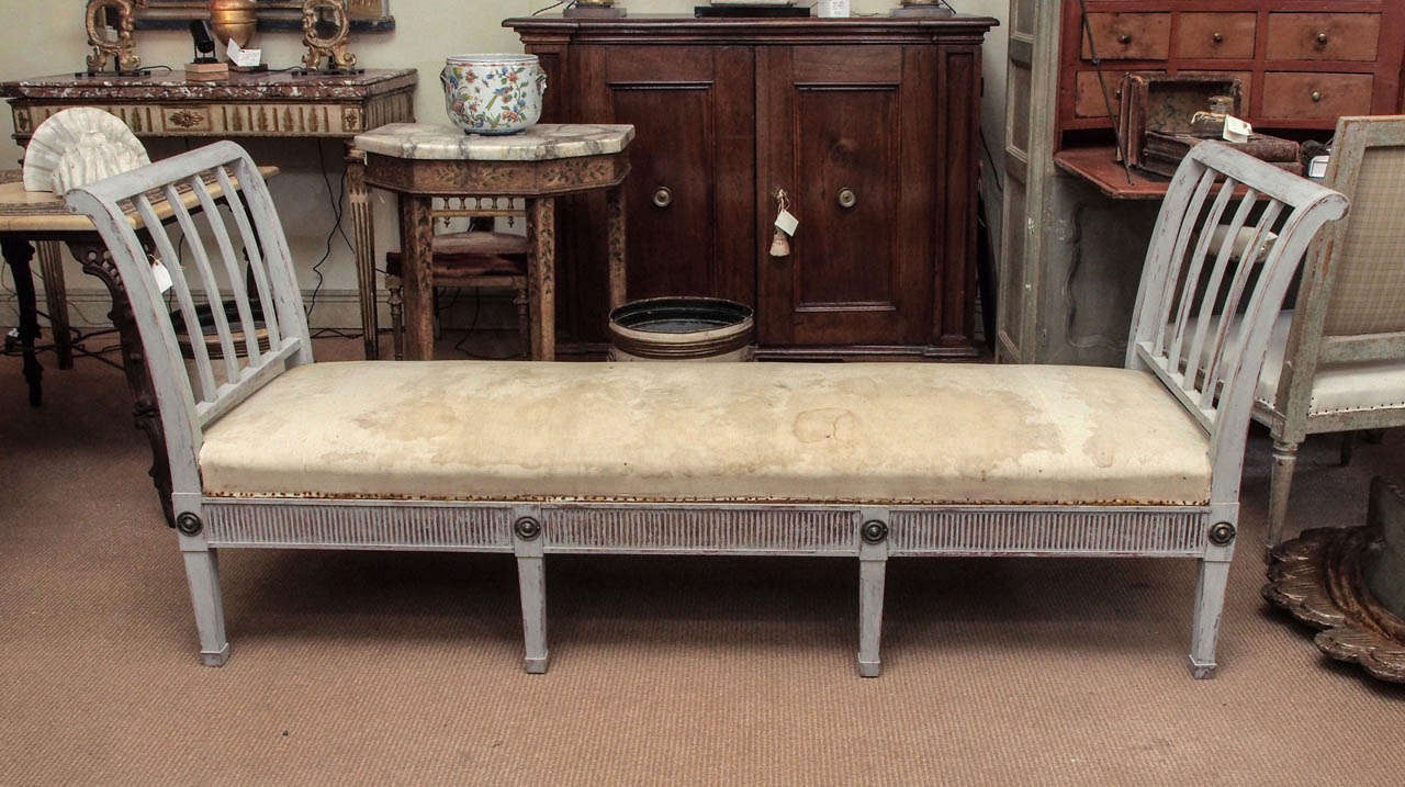 A Swedish painted daybed with brass accents in the Gustavian style.